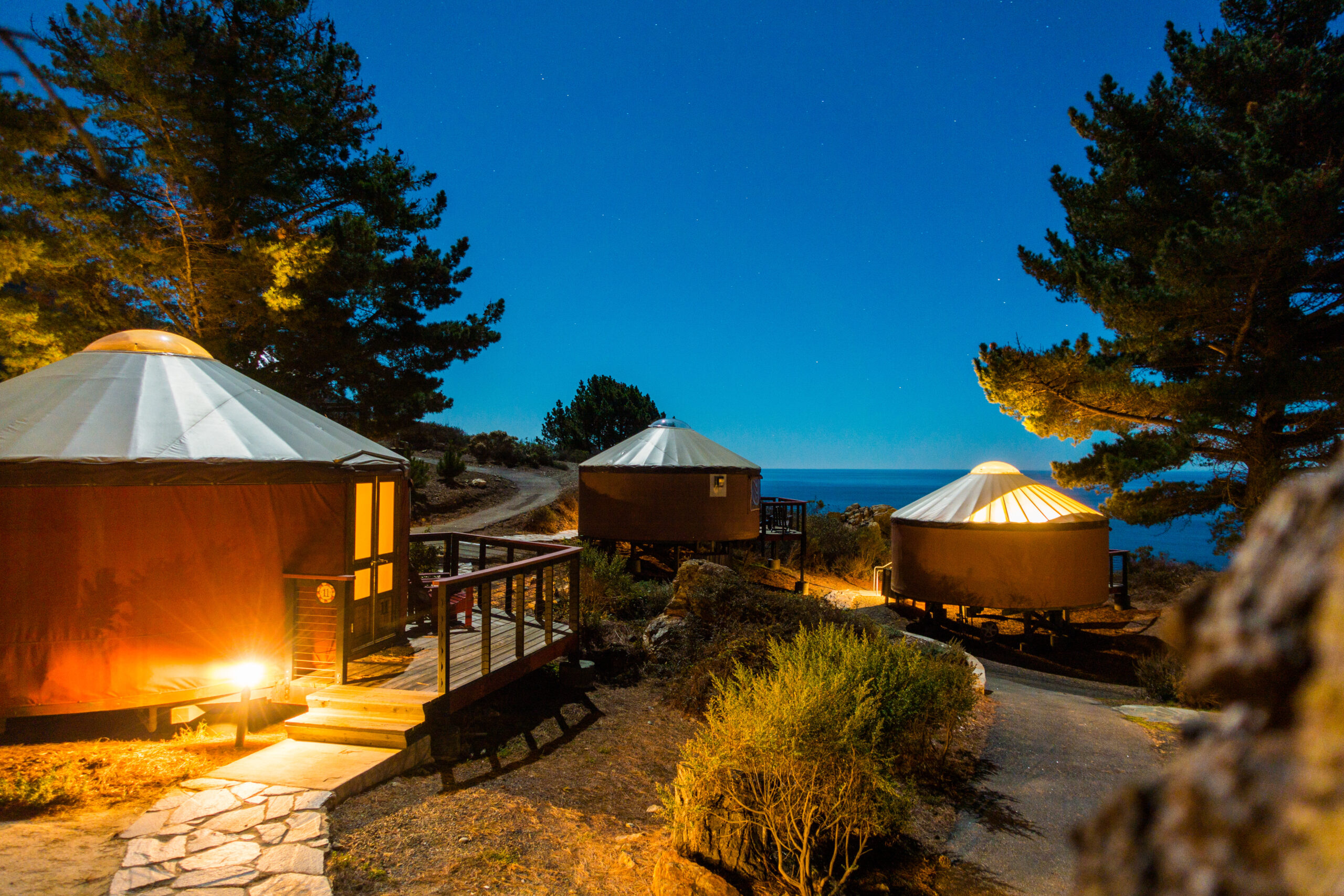 Yurts/tents under starlit sky in the woods, Big Sur, California